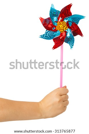 Colorful children's pinwheel in female hand isolated on white background - stock photo