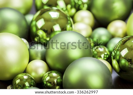 Colorful Christmas background of themed green baubles in assorted sizes and shades in a full frame close up view - stock photo