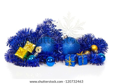 Colorful christmas decoration, blue tinsel, snowflakes isolated on white - stock photo