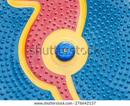 Colorful circle toy in the playground of kindergarten. - stock photo