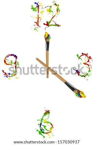 Colorful clock made of paint and painbrushes - stock photo