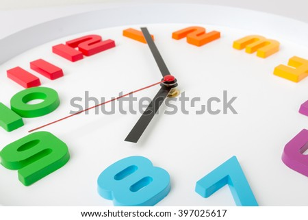 Colorful clock or time abstract background. white clock with red and black needles. - stock photo