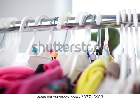 Colorful Closeup of child clothes rack - stock photo