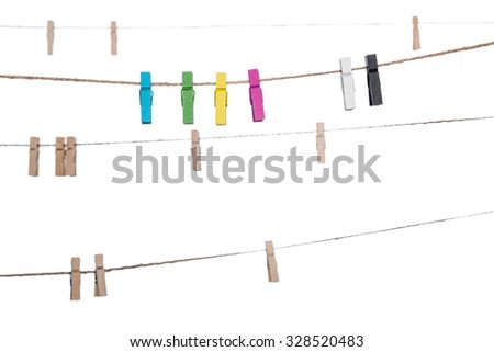 colorful clothespins on a clothesline , clamp peg housework hanging - stock photo