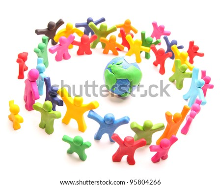 colorful cloud of cheery plasticine people standing around planet earth to protect it - stock photo