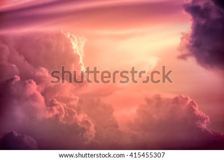 Colorful clouds on the dramatic sunset sky, Color toned image,Dramatic sunset sky with colorful clouds. - stock photo