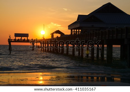 Colorful coastal sunset at the iconic Pier 60 in Clearwater Beach, Florida. - stock photo
