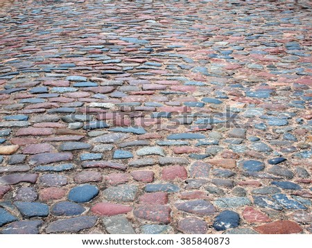Colorful cobblestones on paved street for background.        - stock photo