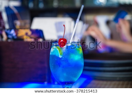 Colorful cocktail in the bar - stock photo