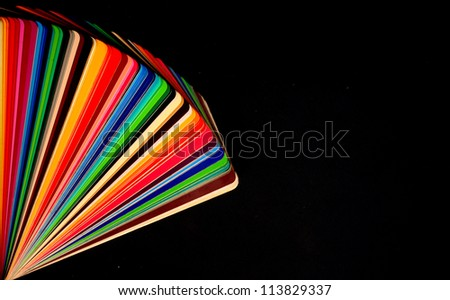 colorful color guide on black background with copy space - stock photo