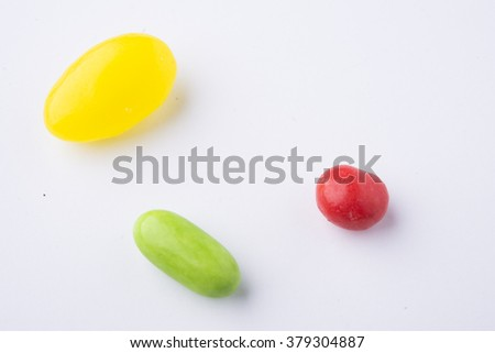 colorful confectionery on white background - stock photo