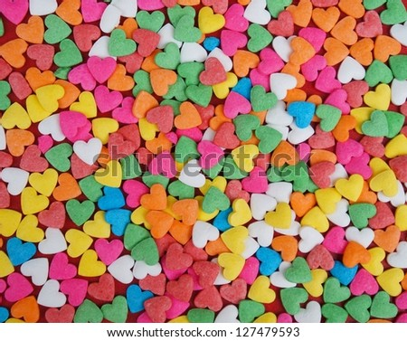 Colorful Confectionery ornaments in the form of red hearts - stock photo