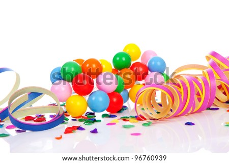 Colorful confetti, balloons and party streamers over white background - stock photo