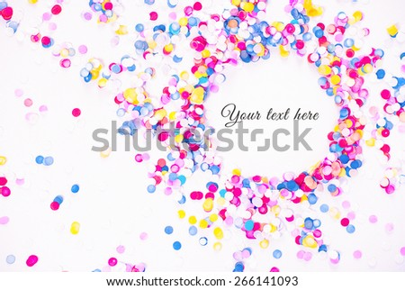 Colorful confetti on white background with sample text - stock photo