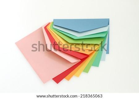 Colorful correspondence envelopes on white background - stock photo