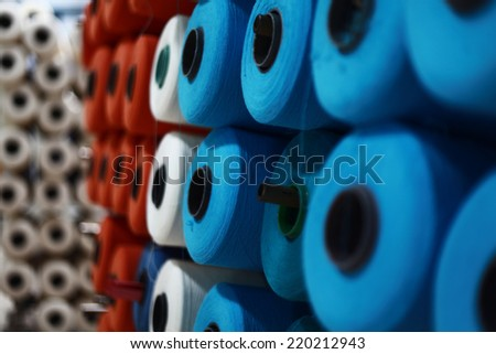Colorful Cotton Thread Bobbins - stock photo