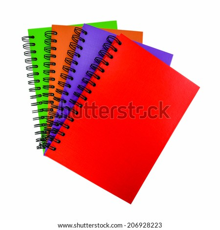 Colorful cover of notebook isolated on white background - stock photo