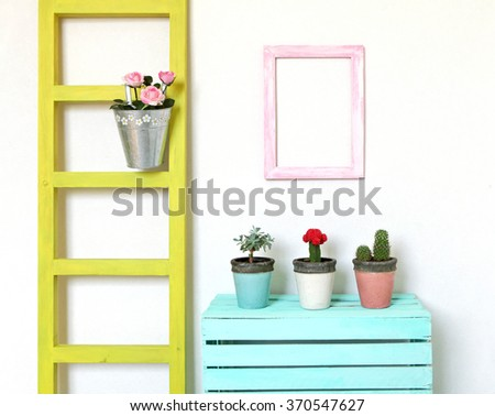 Colorful cozy  interior. Decorations for flowers - stock photo