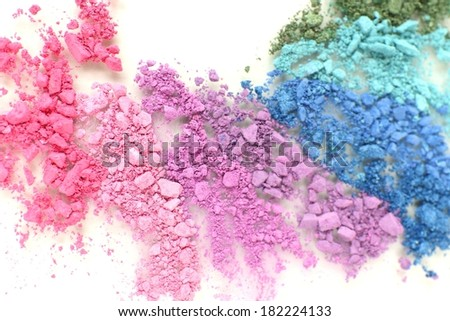 Colorful crushed eyeshadow close up - stock photo