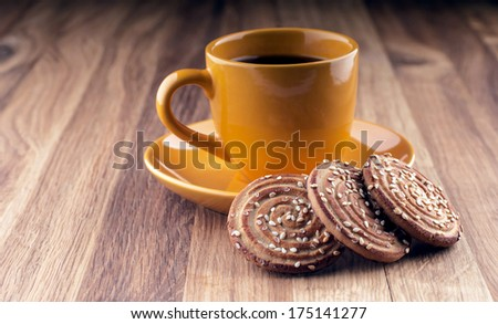 Colorful cup of coffee and cookies on wooden background. - stock photo