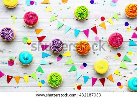 Colorful cupcake party background - stock photo