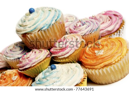 Colorful cupcakes with glitter on a white background - stock photo