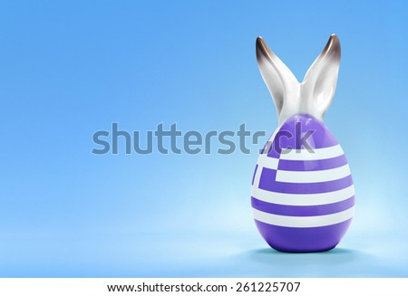 Colorful cute ceramic easter egg with rabbit ears and the flag of Greece .(series) - stock photo
