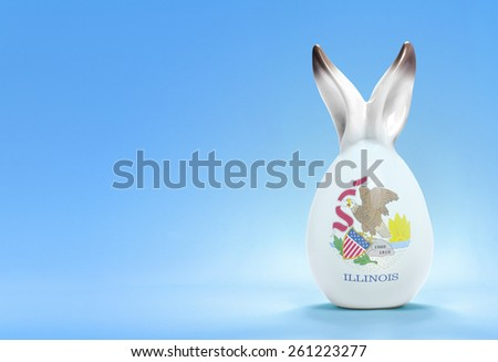 Colorful cute ceramic easter egg with rabbit ears and the flag of Illinois .(series) - stock photo