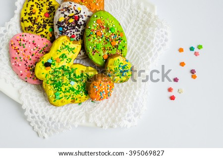Colorful decorated Easter cookies on a plate on white background. Easter homemade gingerbread cookies.  - stock photo