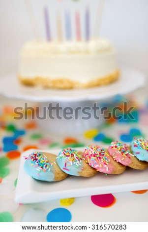 Colorful decoration of kids birthday party table with cake, cookies and sweets - stock photo