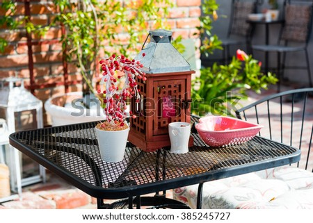 colorful decorations on a garden table  - stock photo