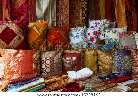 colorful decorative eastern pillows, cushions and fabric at the market - stock photo
