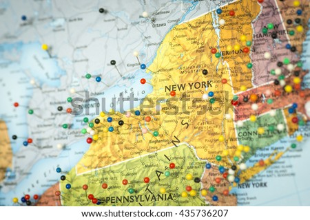 Colorful detail map macro close up with push pins marking locations throughout the United States of America NY New York  - stock photo