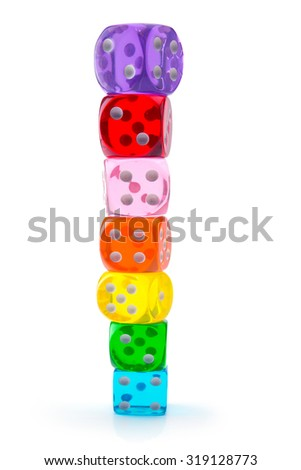 Colorful dice stacked up, isolated on white. Seven transparent acrylic dice in rainbow color stacked up. Shallow depth of field.  - stock photo