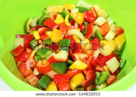 Colorful diced peppers in a green bowl - stock photo