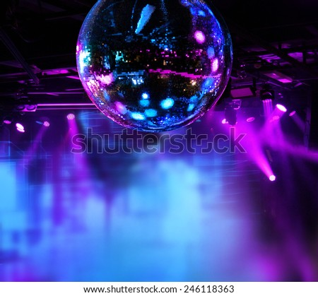 Colorful disco mirror ball lights night club background - stock photo