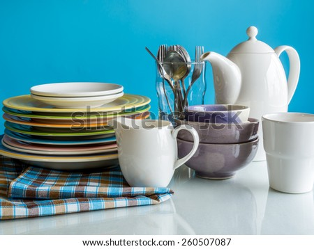 Colorful dishware utensil on table top/ interior of Dining room still life - stock photo