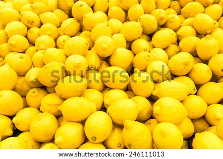 Colorful Display Of Lemons In Fruit Market - stock photo