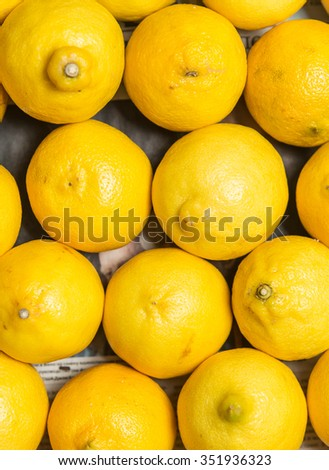 Colorful Display Of Lemons In Market - stock photo