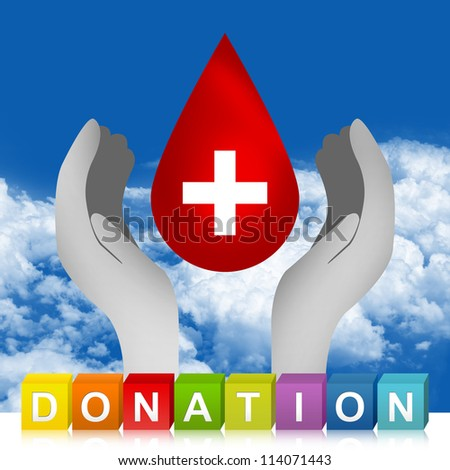 Colorful Donation Cube Box And Blood Drop Over The Hand For Blood Donation Concept in Blue Sky Background - stock photo