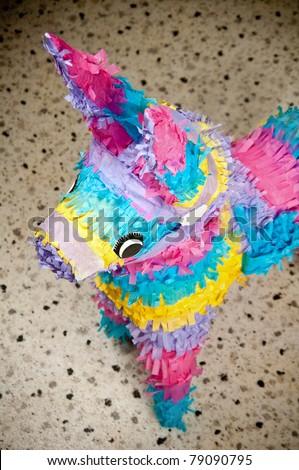 Colorful donkey pinata over blurred background - stock photo