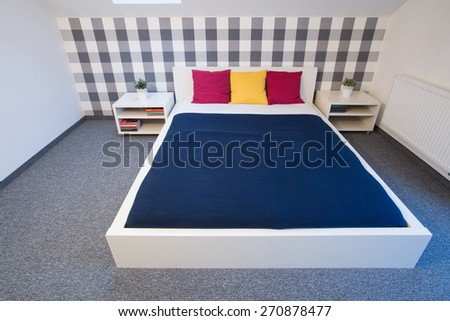 Colorful double bed in fancy bedroom - stock photo