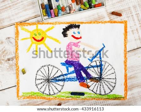 colorful drawing: boy riding bike - stock photo