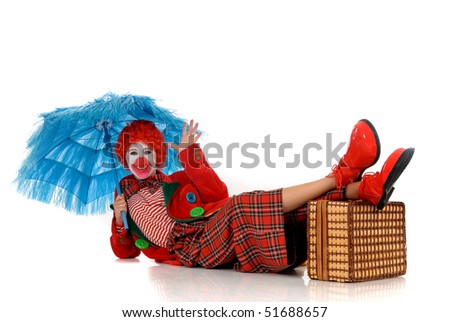 Colorful dressed female holiday clown, happy joyful expression on face. Studio shot. - stock photo