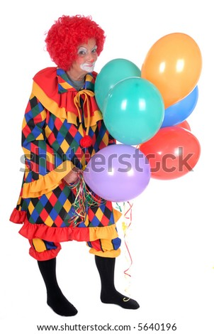 Colorful dressed female holiday clown with balloons, happy joyful expression on face - stock photo