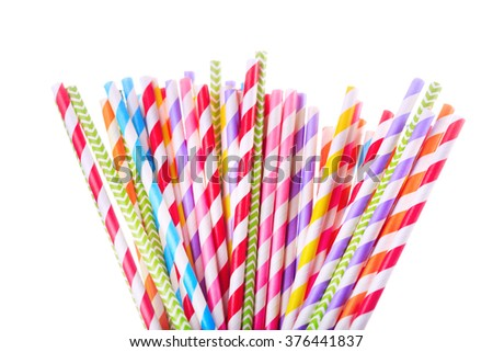 Colorful drinking striped straw isolated on white background - stock photo