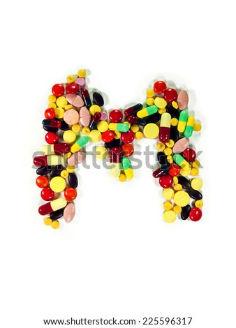 "Colorful drug character ""M"", white isolate, studio shot. - stock photo"