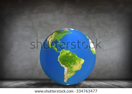 Colorful earth and icons on the wall in the gray room. Elements of this image furnished by NASA - stock photo