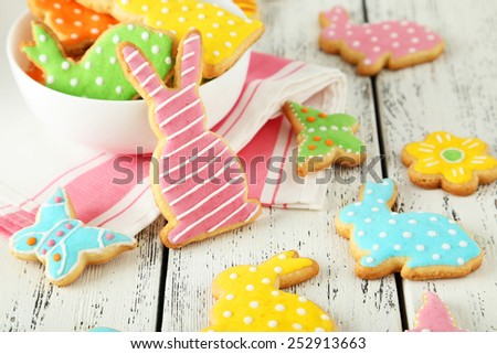 Colorful easter cookies on white wooden background - stock photo