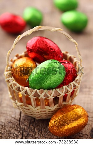 Colorful easter egg candy in basket - stock photo